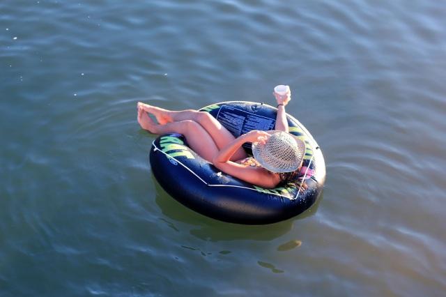 felicia relaxes in the river rat inner tube
